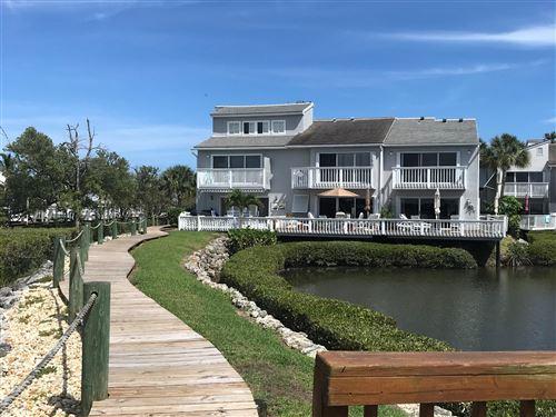 Photo of 2490 Harbour Cove Drive, Hutchinson Island, FL 34949 (MLS # RX-10714829)