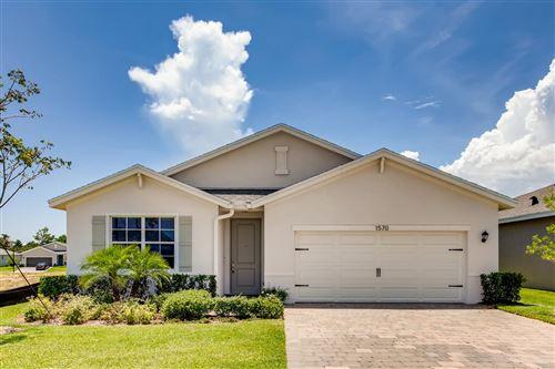 Photo of 1570 NE Skyhigh Terrace, Ocean Breeze, FL 34957 (MLS # RX-10613830)
