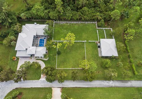 Photo of 6690 NW 67th Place, Parkland, FL 33067 (MLS # RX-10616833)