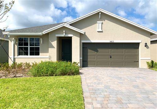 Photo of 1403 NE White Pine Terrace, Ocean Breeze, FL 34957 (MLS # RX-10613835)