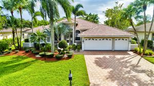 Photo of 9934 NW 65th Manor, Parkland, FL 33076 (MLS # RX-10560836)