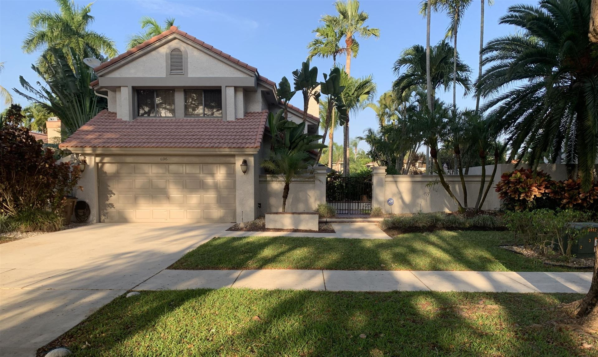 Photo of 696 NW 38th Avenue, Deerfield Beach, FL 33442 (MLS # RX-10710836)