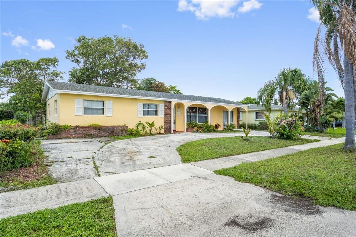 Photo of 421 W 31st Street, Riviera Beach, FL 33404 (MLS # RX-10728836)