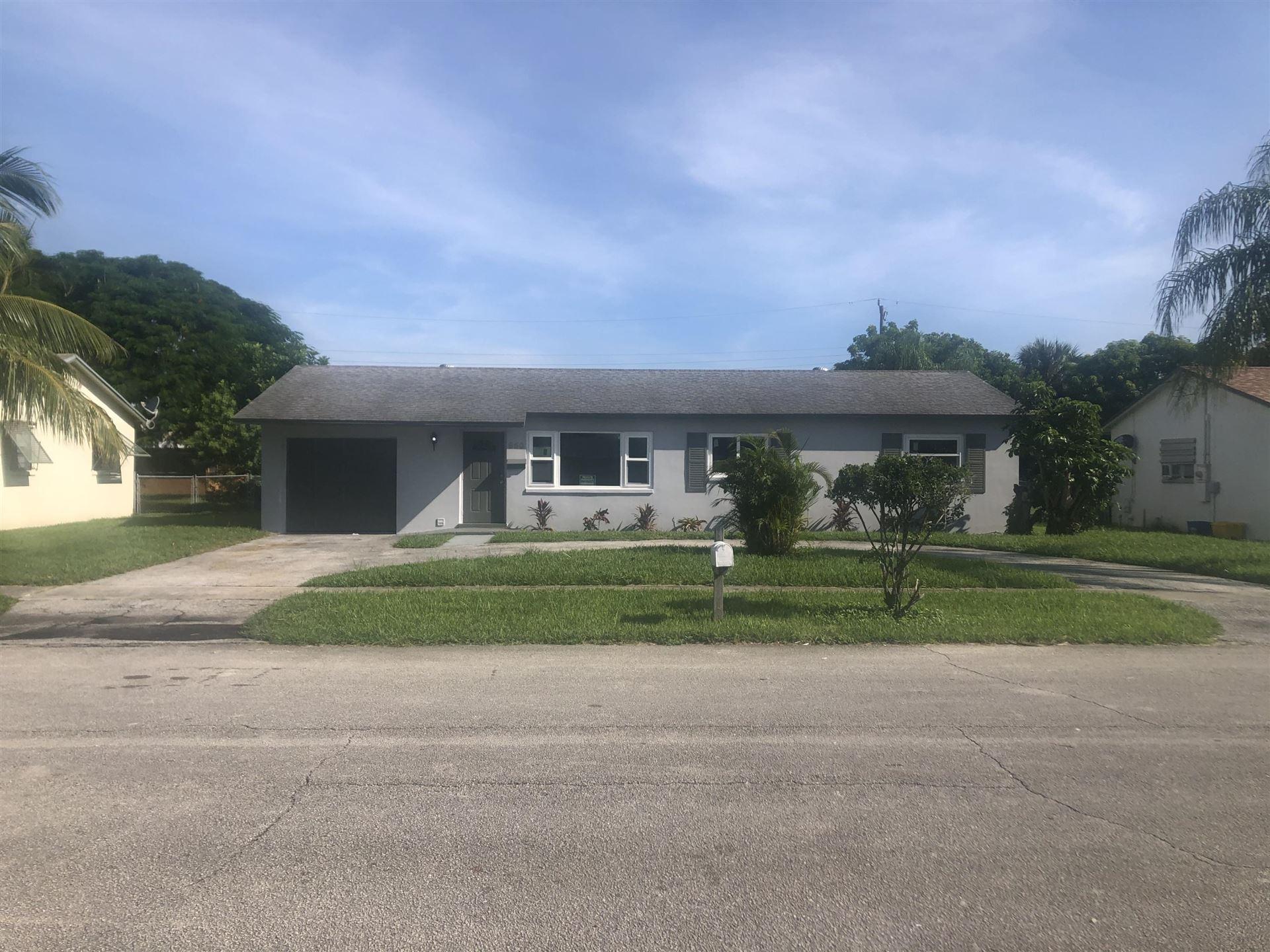 Photo of 650 W 36th Street, Riviera Beach, FL 33404 (MLS # RX-10656838)