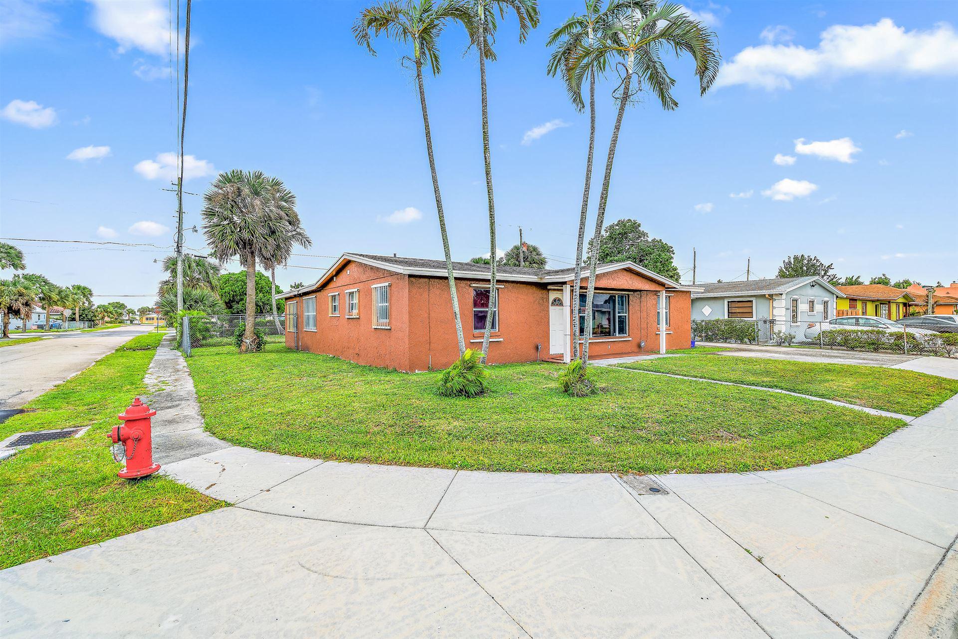 Photo of 1301 W 26th Street, Riviera Beach, FL 33404 (MLS # RX-10669838)
