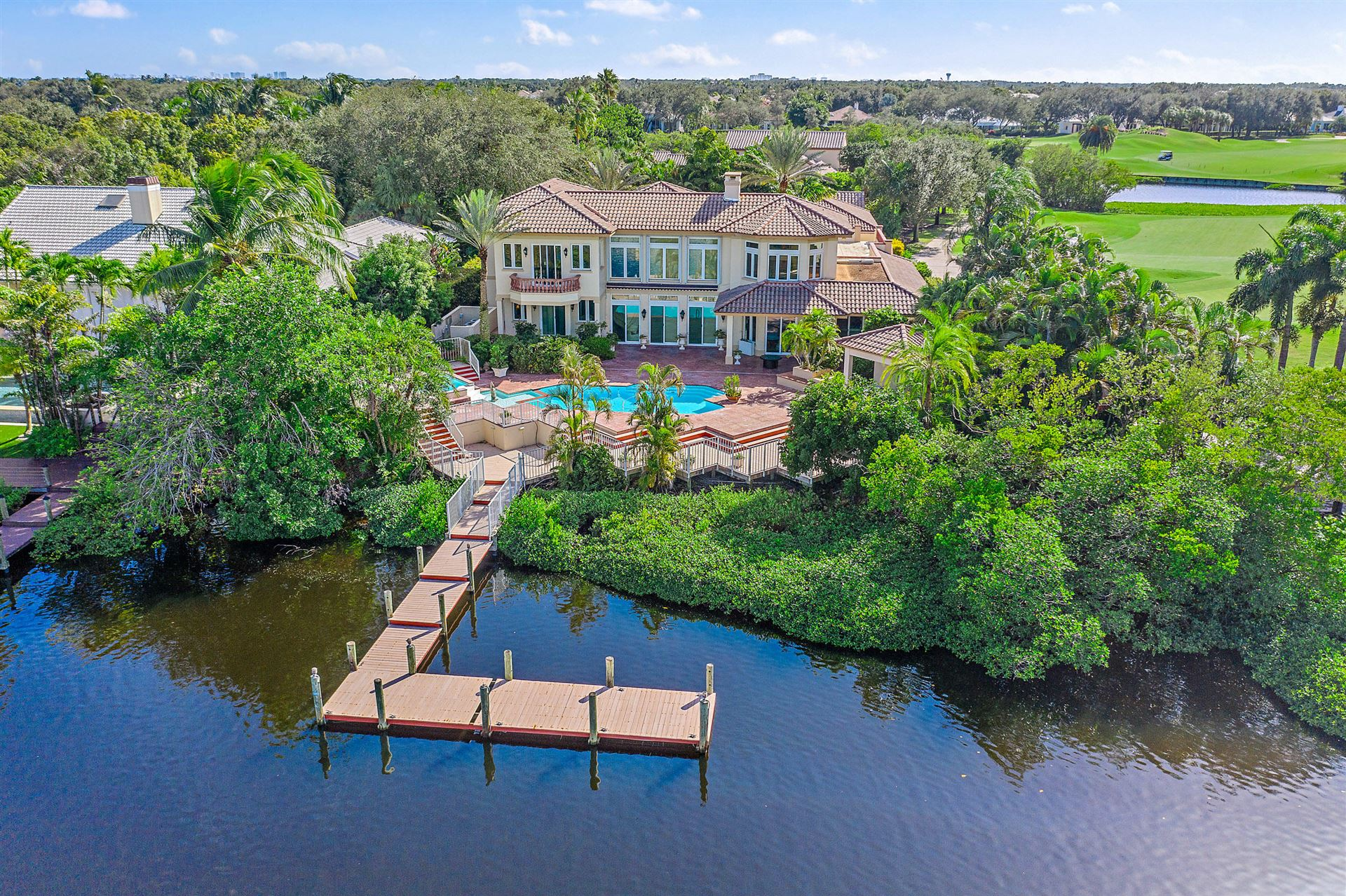 Photo of 127 Spinnaker Lane, Jupiter, FL 33477 (MLS # RX-10666839)
