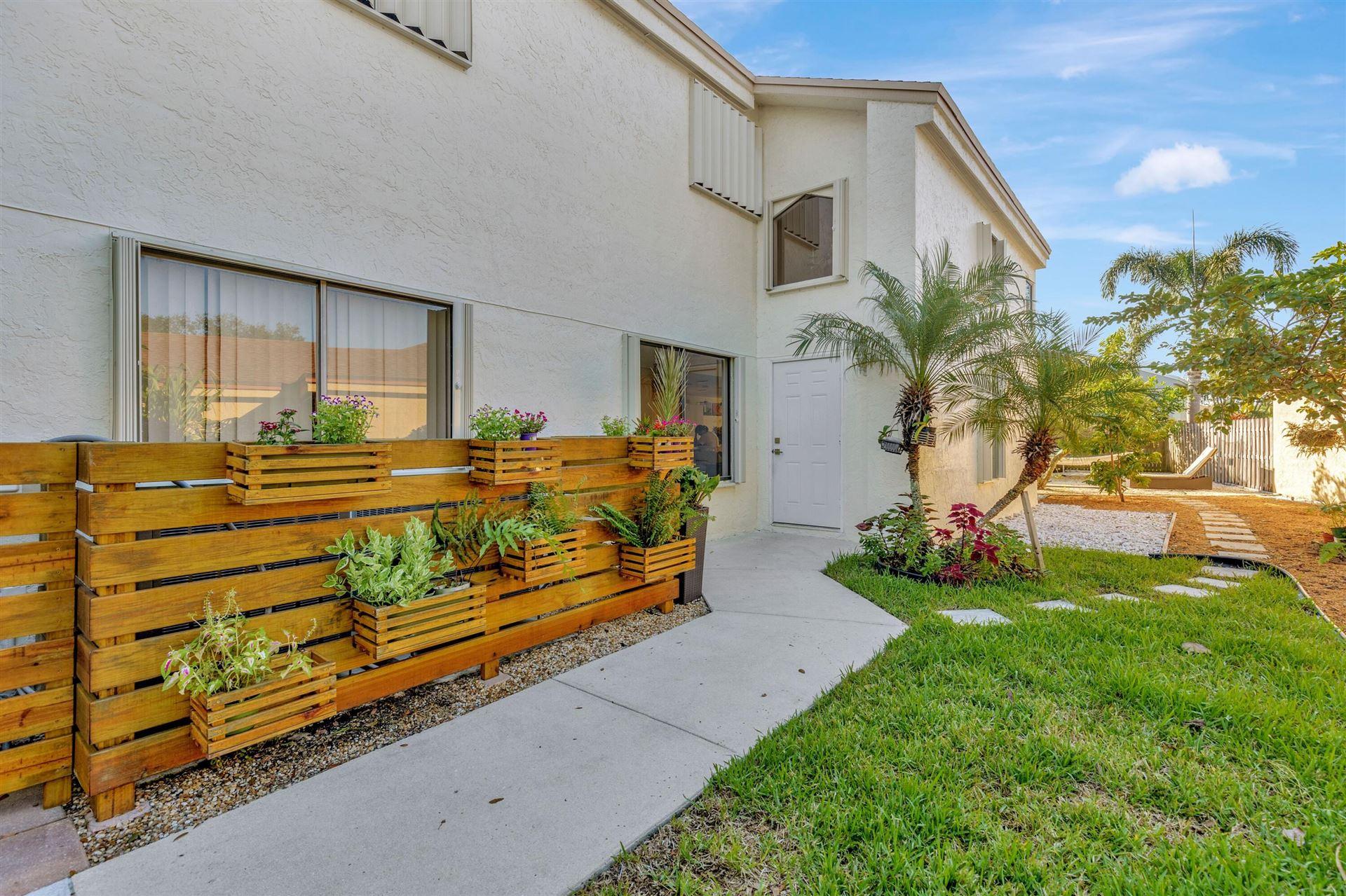 Photo of 3840 NW 21 Street, Coconut Creek, FL 33066 (MLS # RX-10750843)