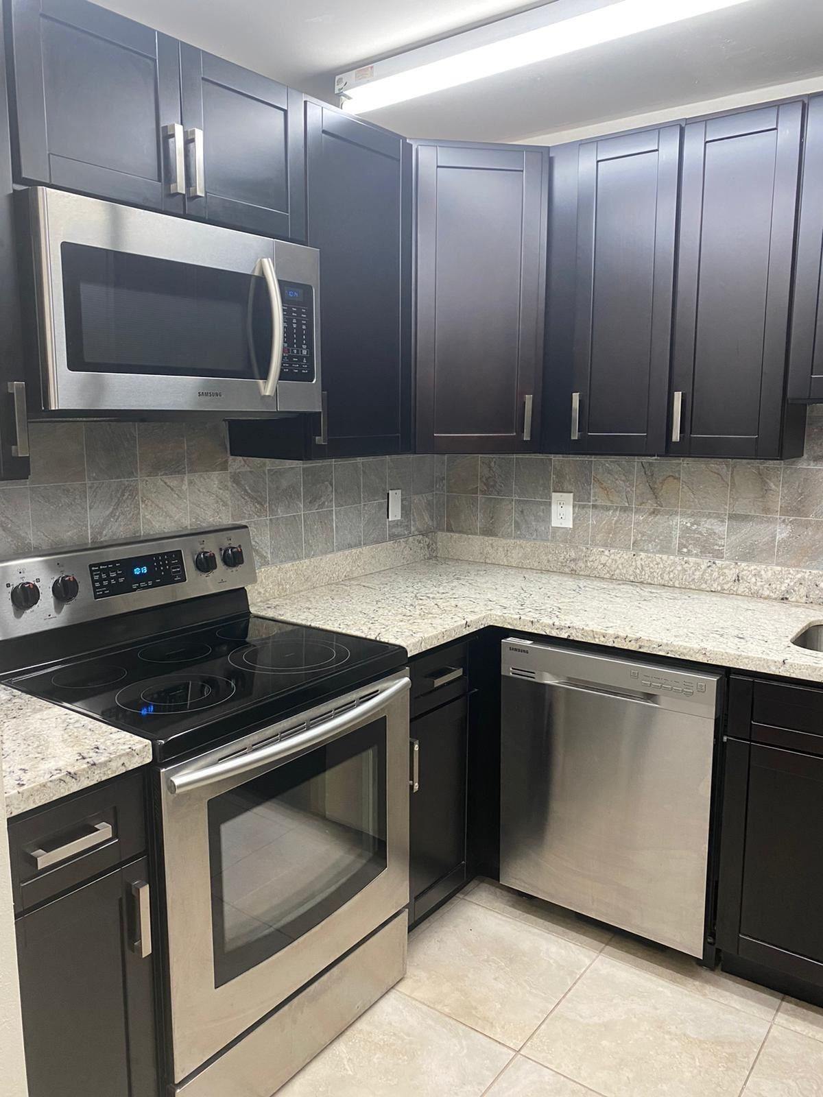 Photo of 2017 NW 46th Avenue #A302, Lauderhill, FL 33313 (MLS # RX-10752847)