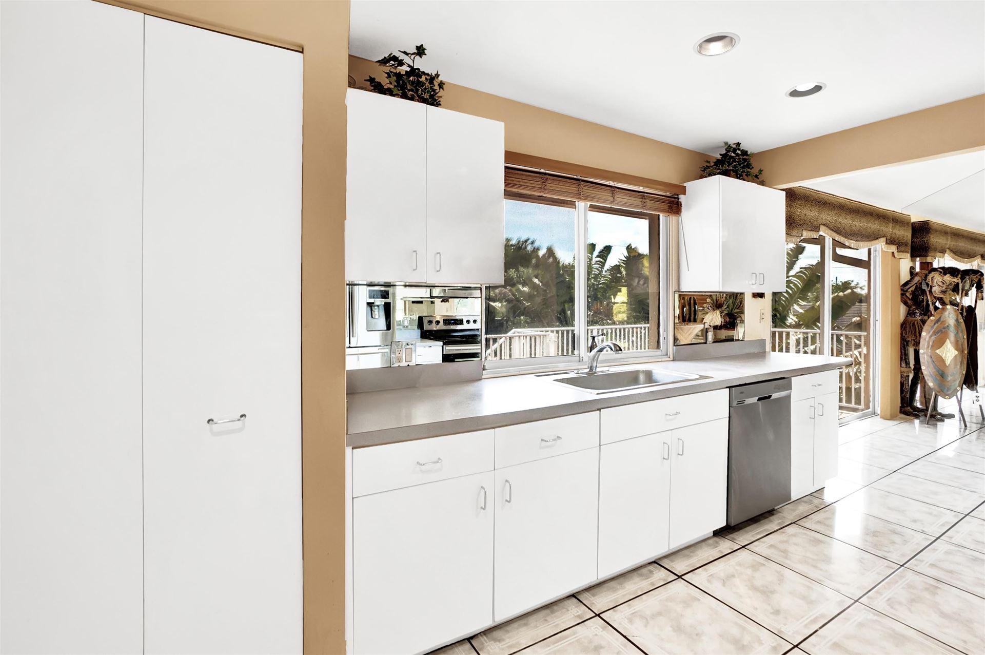 Photo of 1460 SW 24th Terrace, Deerfield Beach, FL 33442 (MLS # RX-10690850)