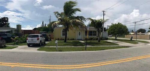 Photo of 562 Cherry Road, West Palm Beach, FL 33409 (MLS # RX-10697851)
