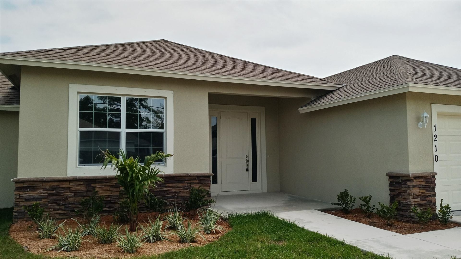 Photo of 1210 SW Jericho Avenue, Port Saint Lucie, FL 34953 (MLS # RX-10708853)