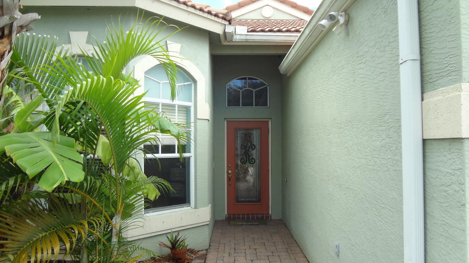 Photo of 239 NW Red Cedar Street, Jensen Beach, FL 34957 (MLS # RX-10644858)