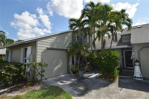 Photo of 931 NE Sandalwood Place, Jensen Beach, FL 34957 (MLS # RX-10714861)