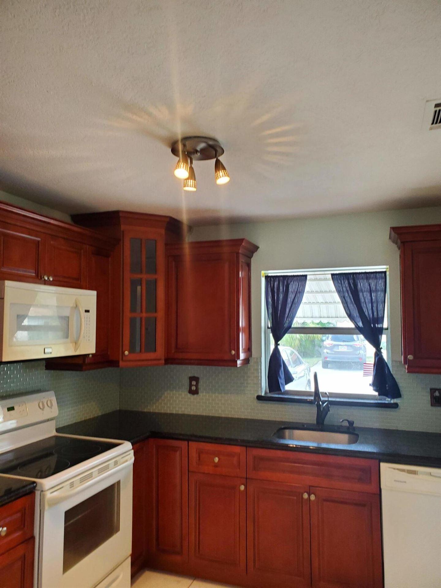 Photo of 417 SW Natura Avenue #B, Deerfield Beach, FL 33441 (MLS # RX-10691861)