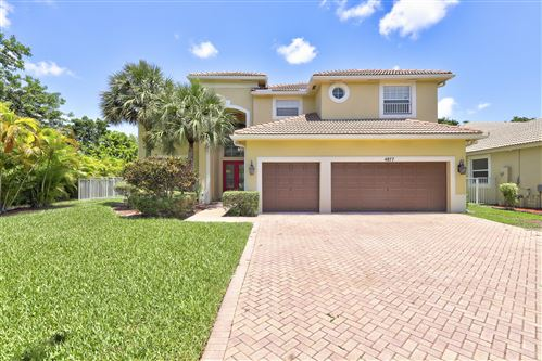 Photo of 4877 NW 72 Place, Coconut Creek, FL 33073 (MLS # RX-10625870)