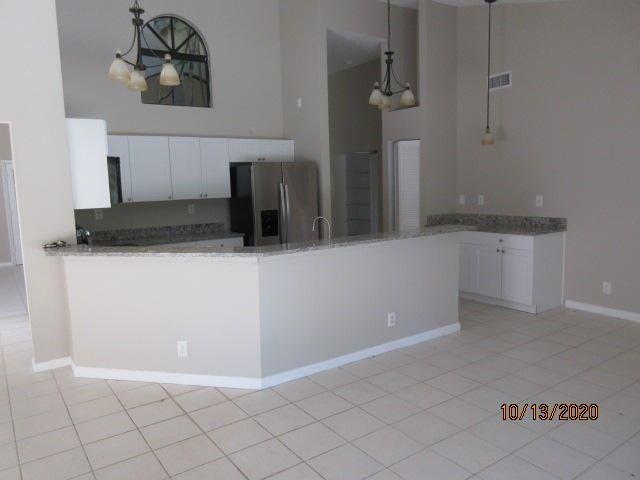 Photo of 5085 Monterey Lane, Delray Beach, FL 33484 (MLS # RX-10675870)