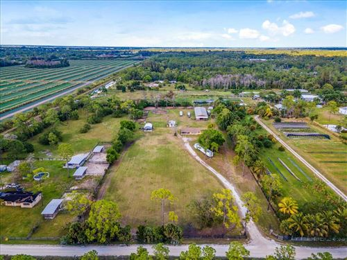 Photo of 15897 Collecting Canal Road, Loxahatchee Groves, FL 33470 (MLS # RX-10721872)