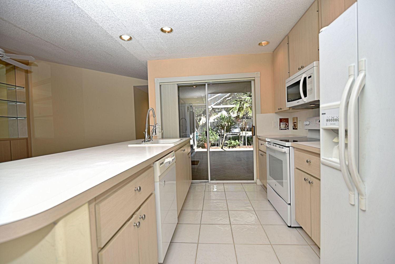 Photo of 9202 Chapman Oak Court, Palm Beach Gardens, FL 33410 (MLS # RX-10676873)