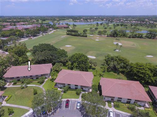 Photo of 464 Brackenwood Lane S, Palm Beach Gardens, FL 33418 (MLS # RX-10634875)