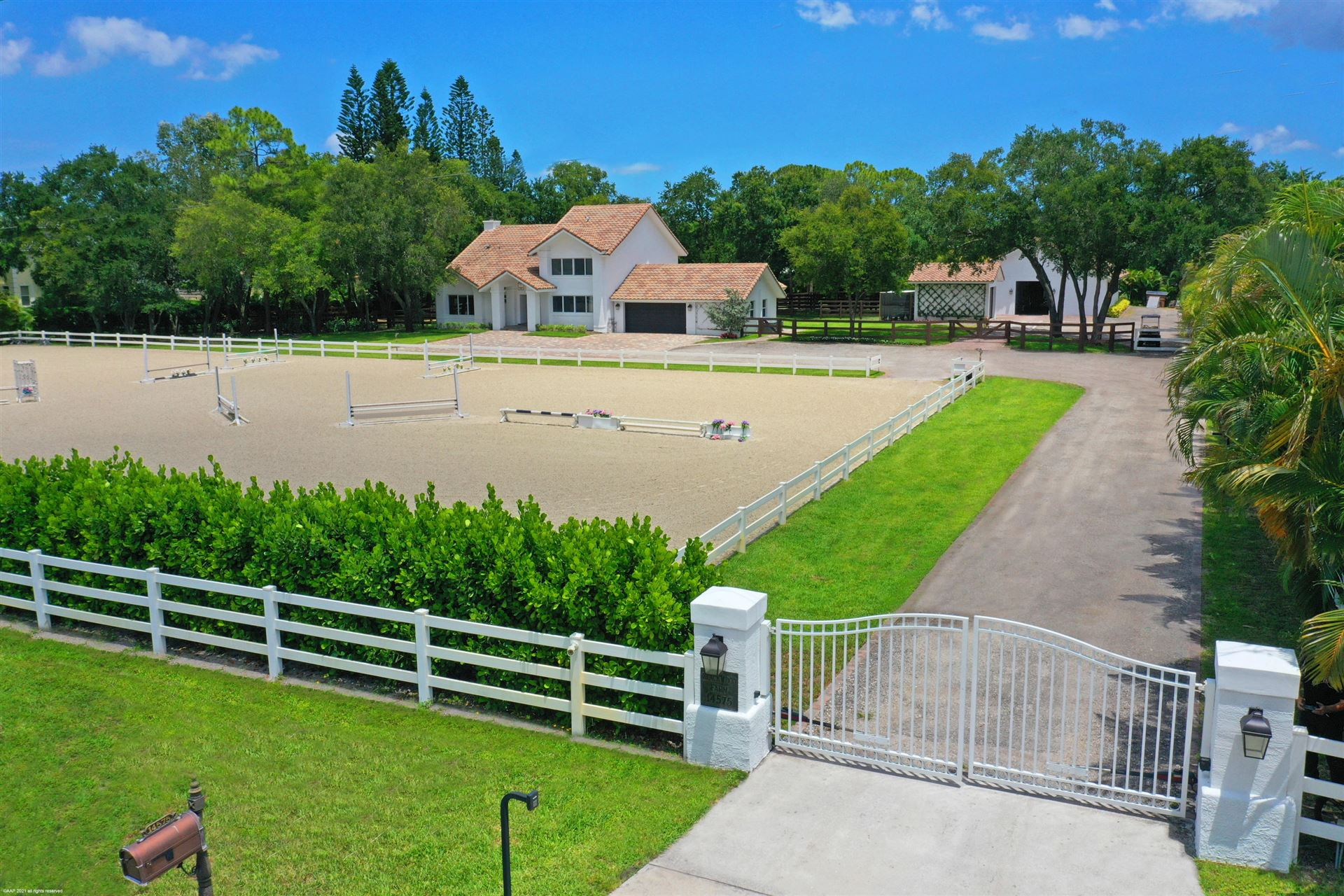 Photo of 14575 Draft Horse Lane, Wellington, FL 33414 (MLS # RX-10716877)