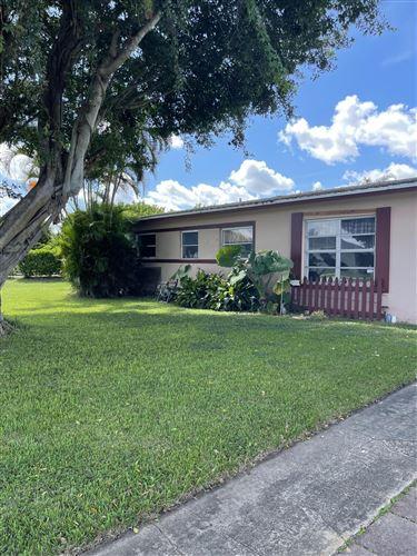 Photo of 820 9th Street, Lake Park, FL 33403 (MLS # RX-10749878)