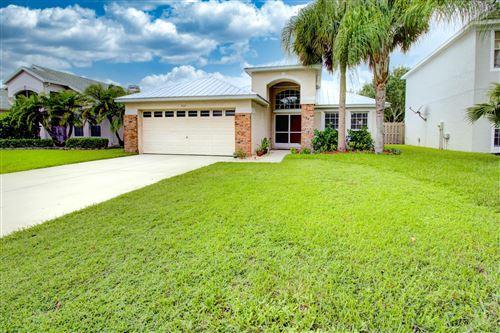 Photo of 864 NW Waterlily Place, Jensen Beach, FL 34957 (MLS # RX-10640879)