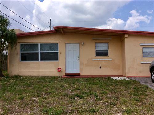 Photo of 1959 Violet Avenue, West Palm Beach, FL 33415 (MLS # RX-10716880)