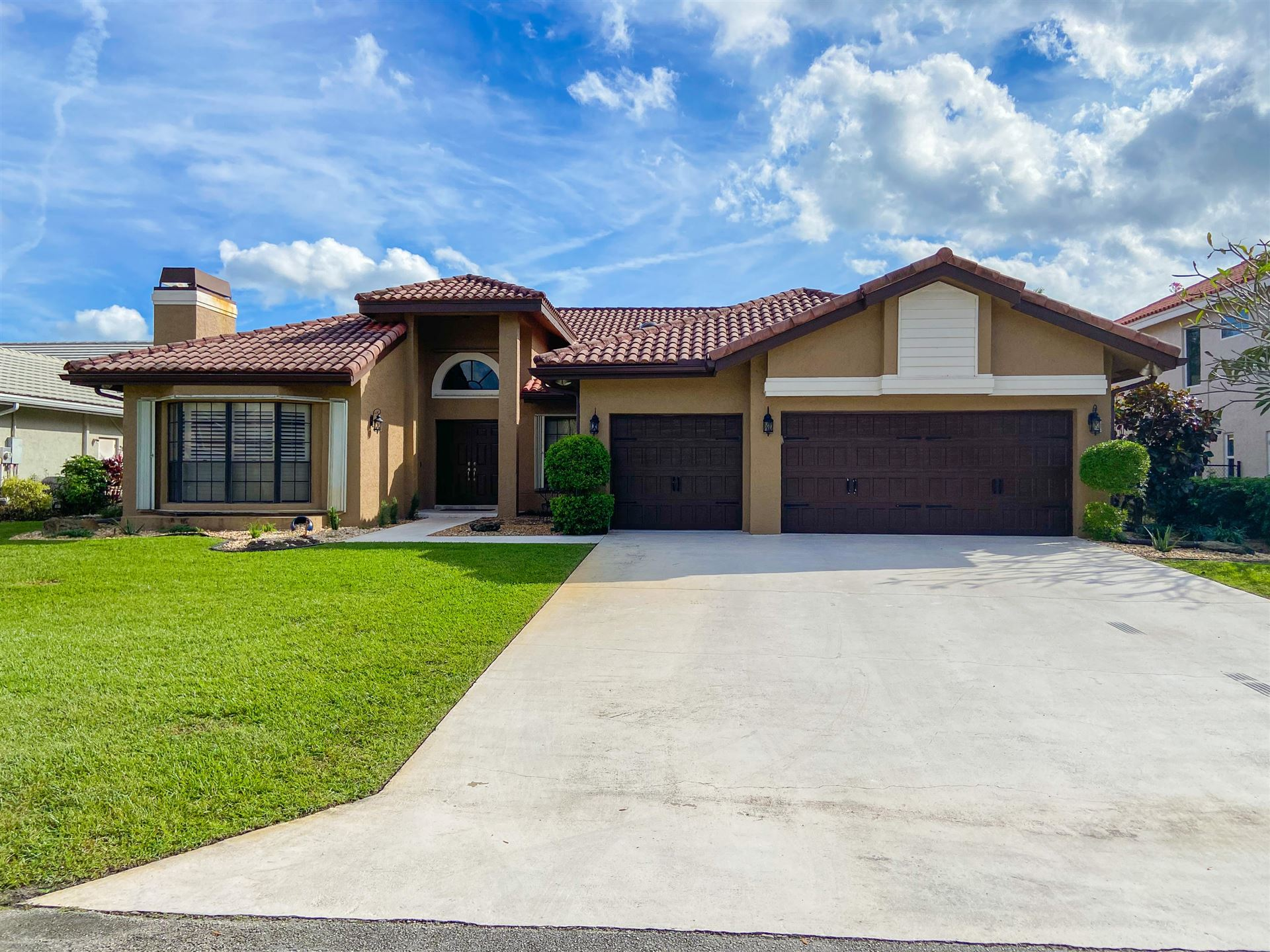 Photo of 6020 NW 62nd Court, Parkland, FL 33067 (MLS # RX-10674881)