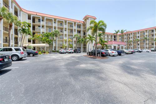 Photo of 105 Paradise Harbour Boulevard #111, North Palm Beach, FL 33408 (MLS # RX-10710882)