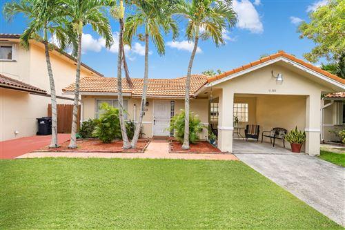 Photo of 11302 SW 73rd Terrace, Miami, FL 33173 (MLS # RX-10743884)