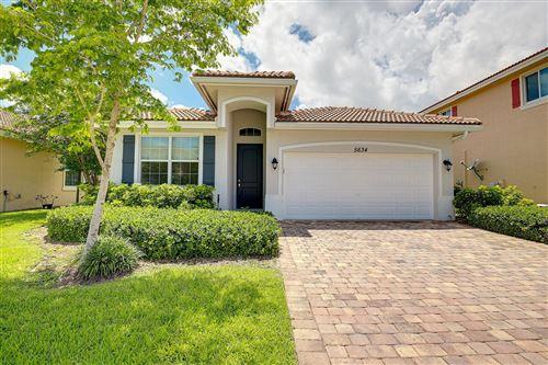 Photo of 5634 Caranday Palm Drive, Greenacres, FL 33463 (MLS # RX-10632885)