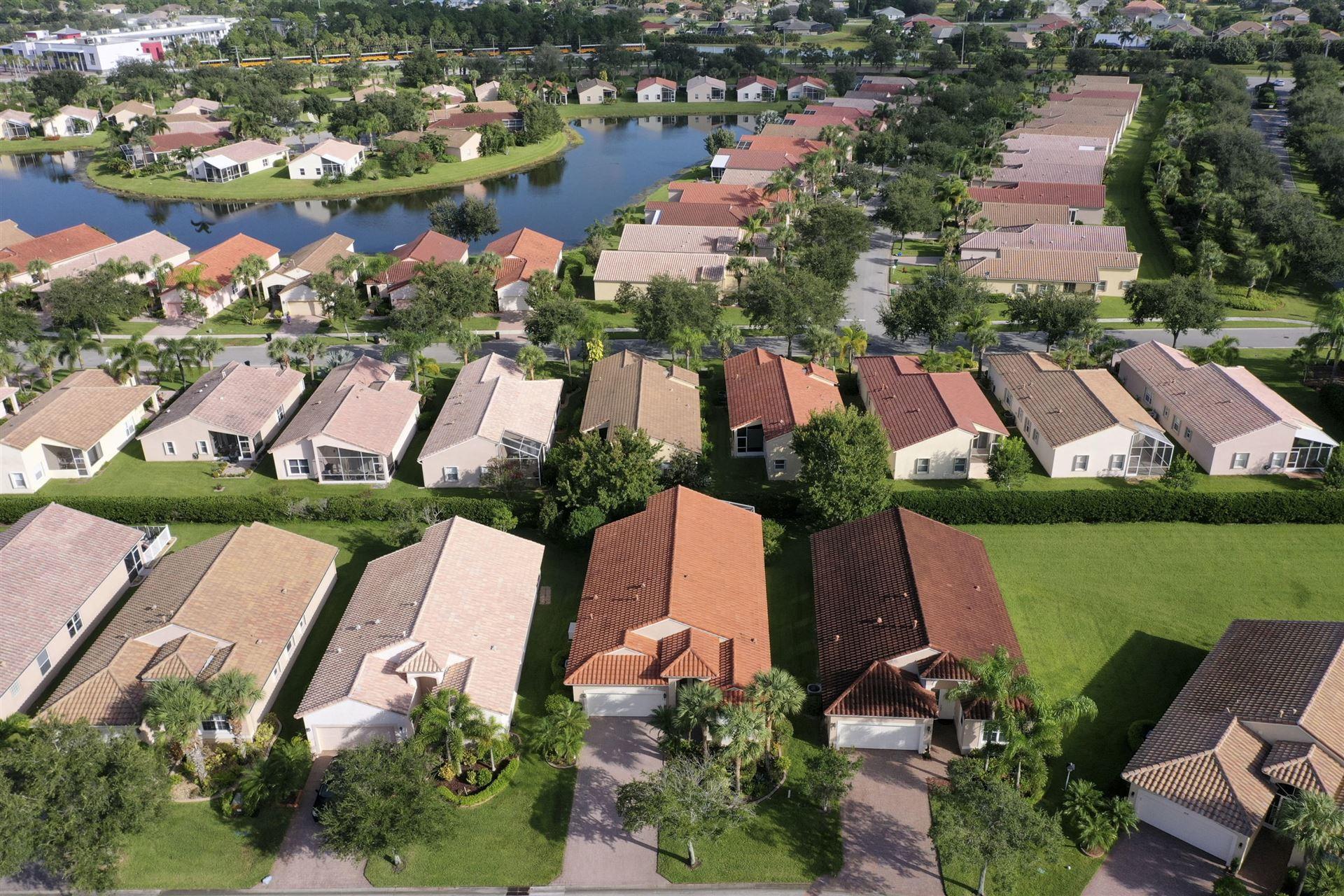 Photo of 405 NW Springview Loop, Port Saint Lucie, FL 34986 (MLS # RX-10652892)
