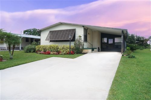 Photo of 7715 SE Independence Avenue, Hobe Sound, FL 33455 (MLS # RX-10636898)