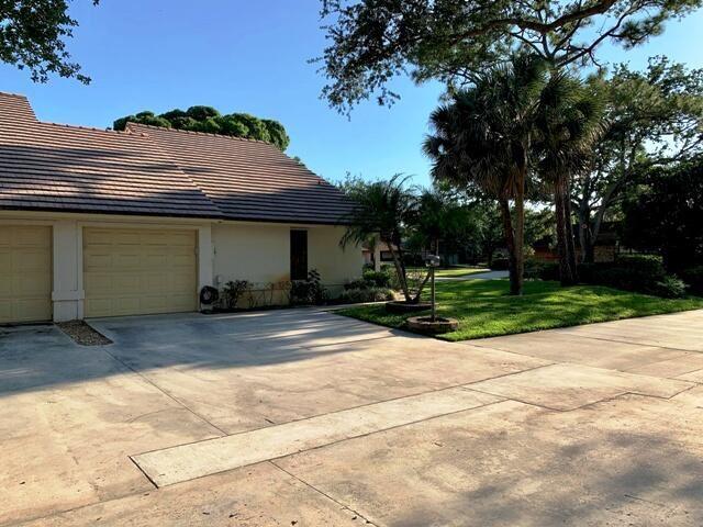 Photo of 700 Kintyre Terrace, Palm Beach Gardens, FL 33418 (MLS # RX-10708900)