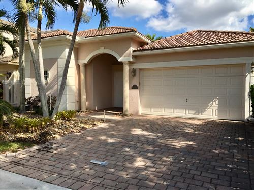 Photo of 5857 NW 122nd Drive, Coral Springs, FL 33076 (MLS # RX-10583904)
