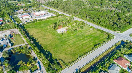 Photo of 12900 Okeechobee Boulevard, Loxahatchee Groves, FL 33470 (MLS # RX-10566906)