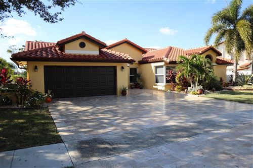 Photo of 10760 Fox Glen Drive, Boca Raton, FL 33428 (MLS # RX-10583909)