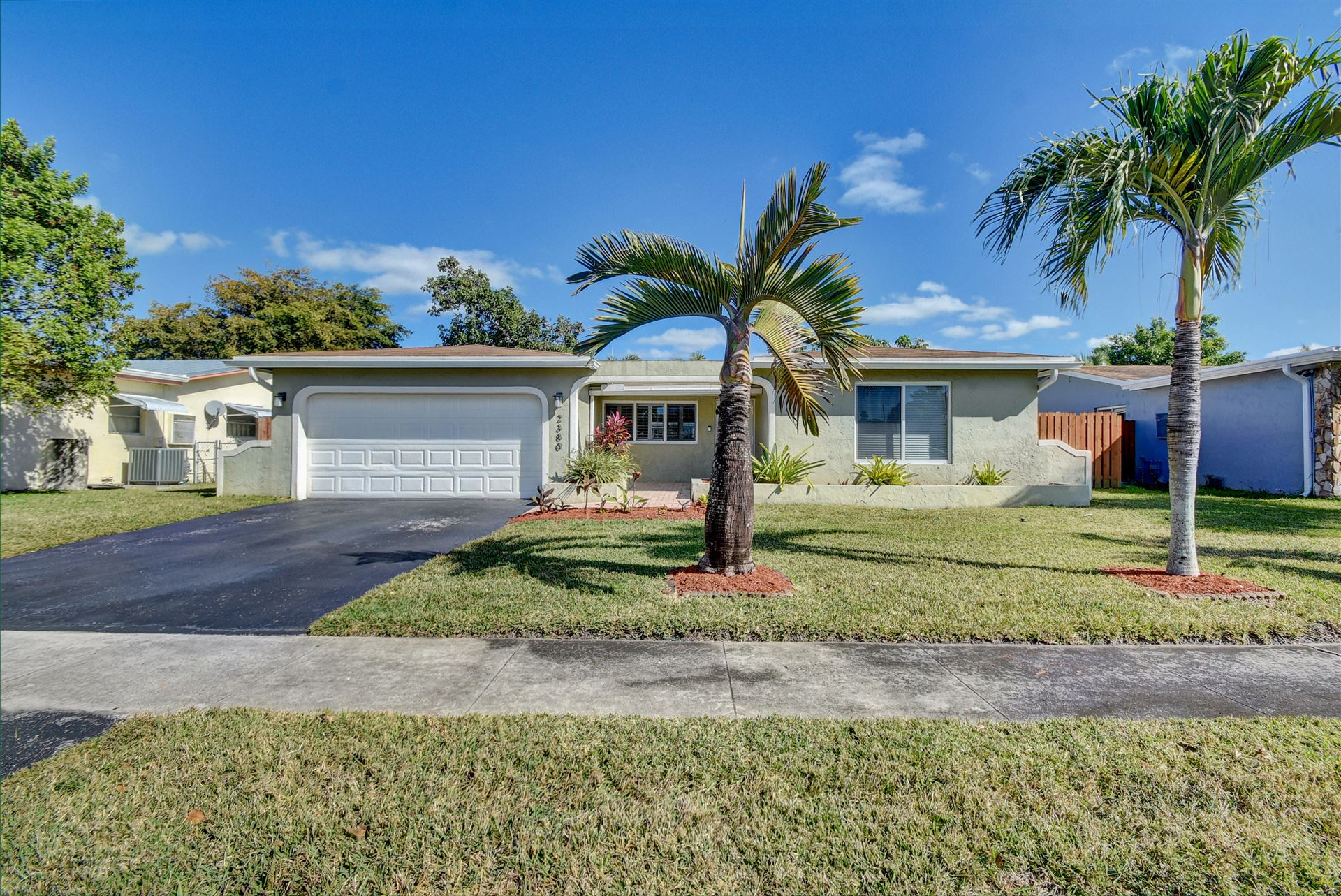 Photo of 2380 NW 94 Way, Sunrise, FL 33322 (MLS # RX-10687909)