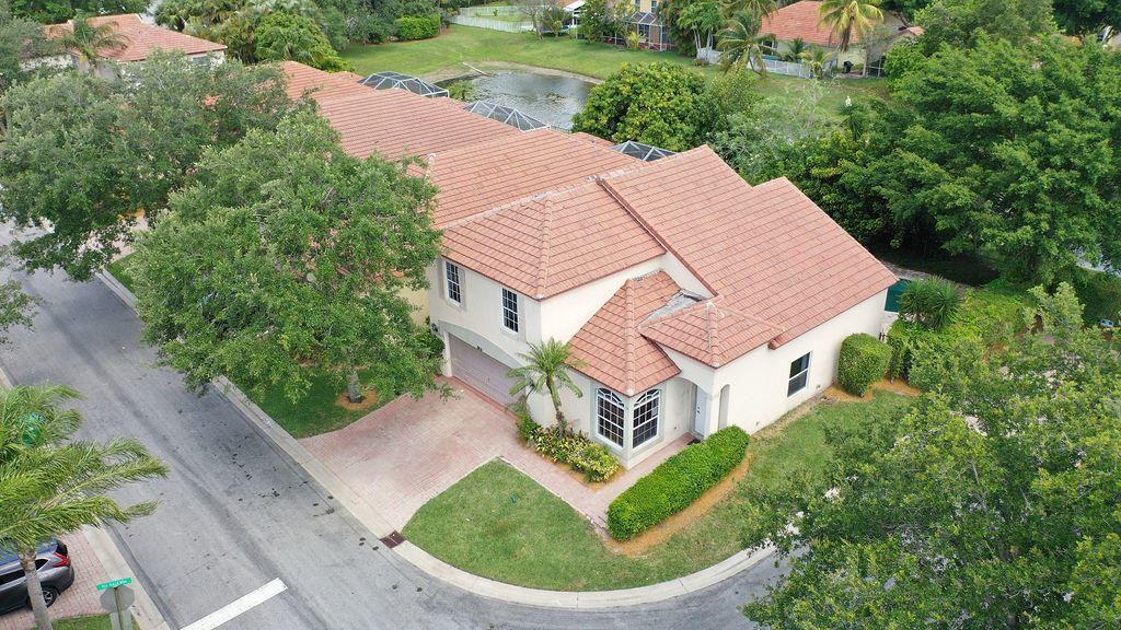 Photo of 8011 Via Hacienda, Riviera Beach, FL 33418 (MLS # RX-10714909)