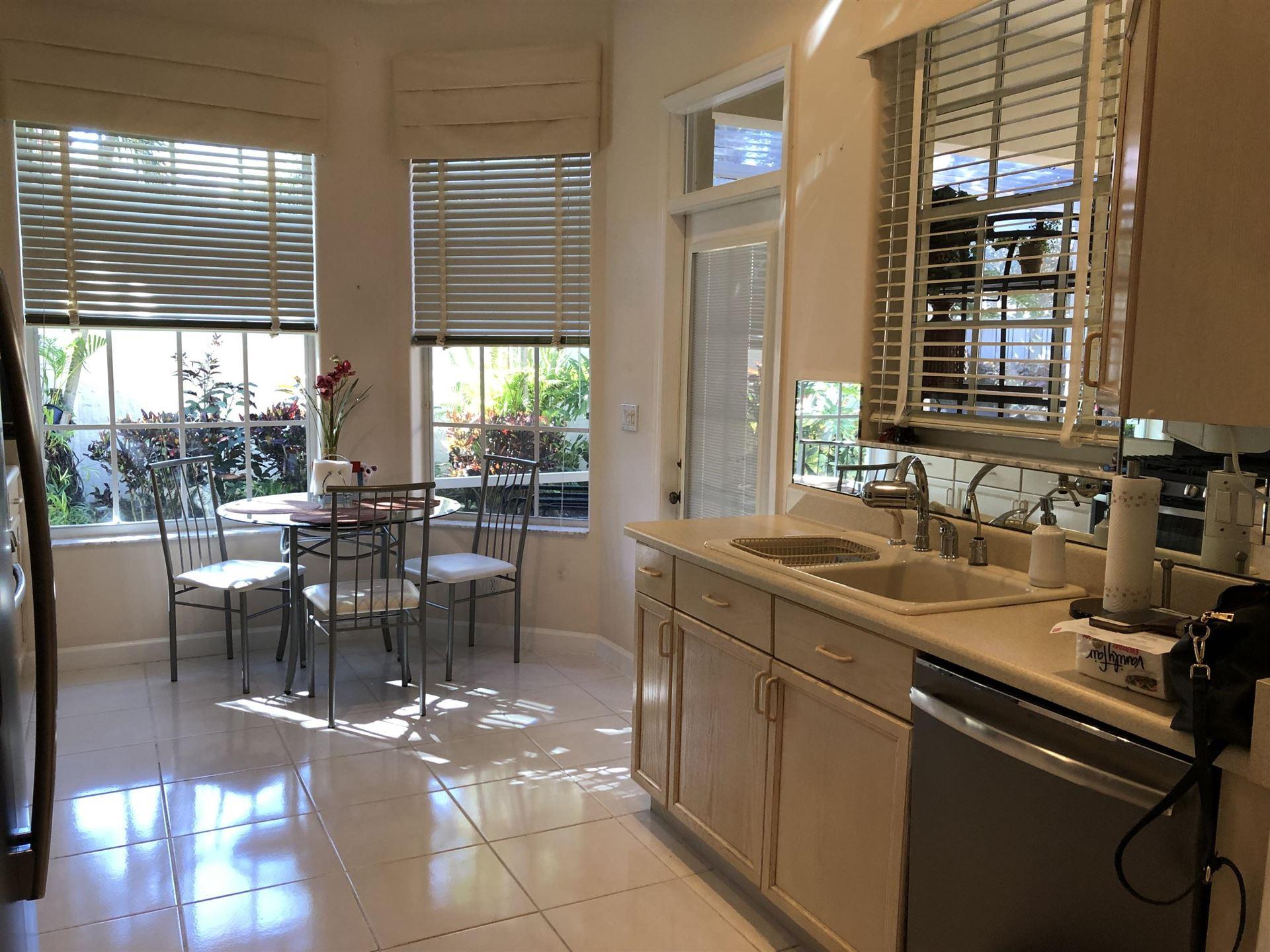 Photo of 132 Monterey Pointe Drive, Palm Beach Gardens, FL 33418 (MLS # RX-10603911)