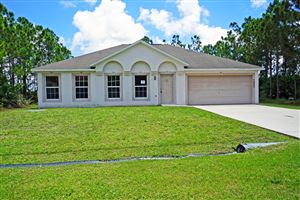 Photo of 5865 NW Carovel Avenue, Port Saint Lucie, FL 34986 (MLS # RX-10530912)