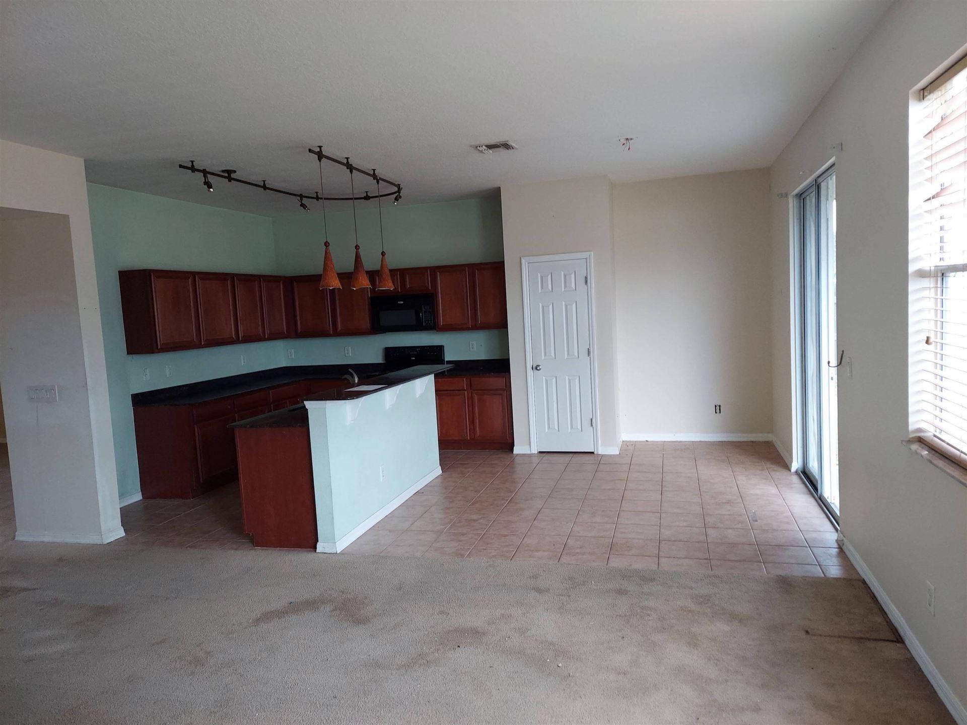 Photo of 4661 SW Eagle Street, Port Saint Lucie, FL 34953 (MLS # RX-10635912)
