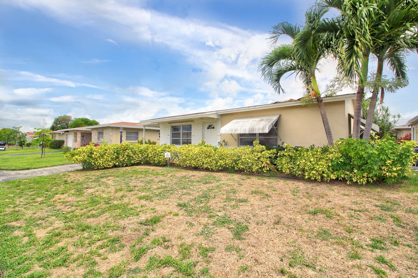 Photo of 1121 NW 48th Place N, Deerfield Beach, FL 33064 (MLS # RX-10714918)