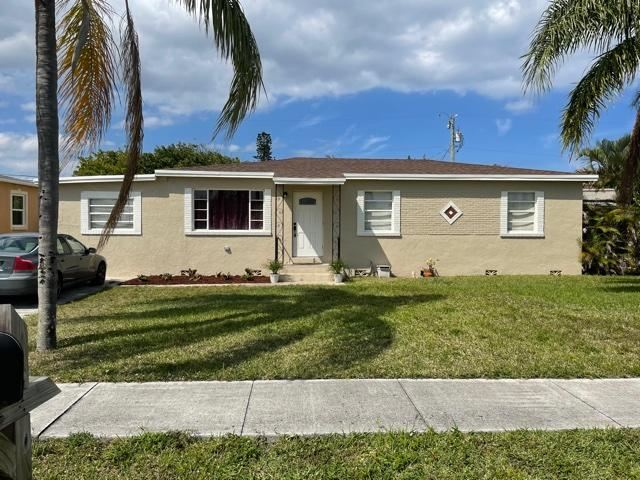 Photo of 360 W 25th Street, Riviera Beach, FL 33404 (MLS # RX-10712921)