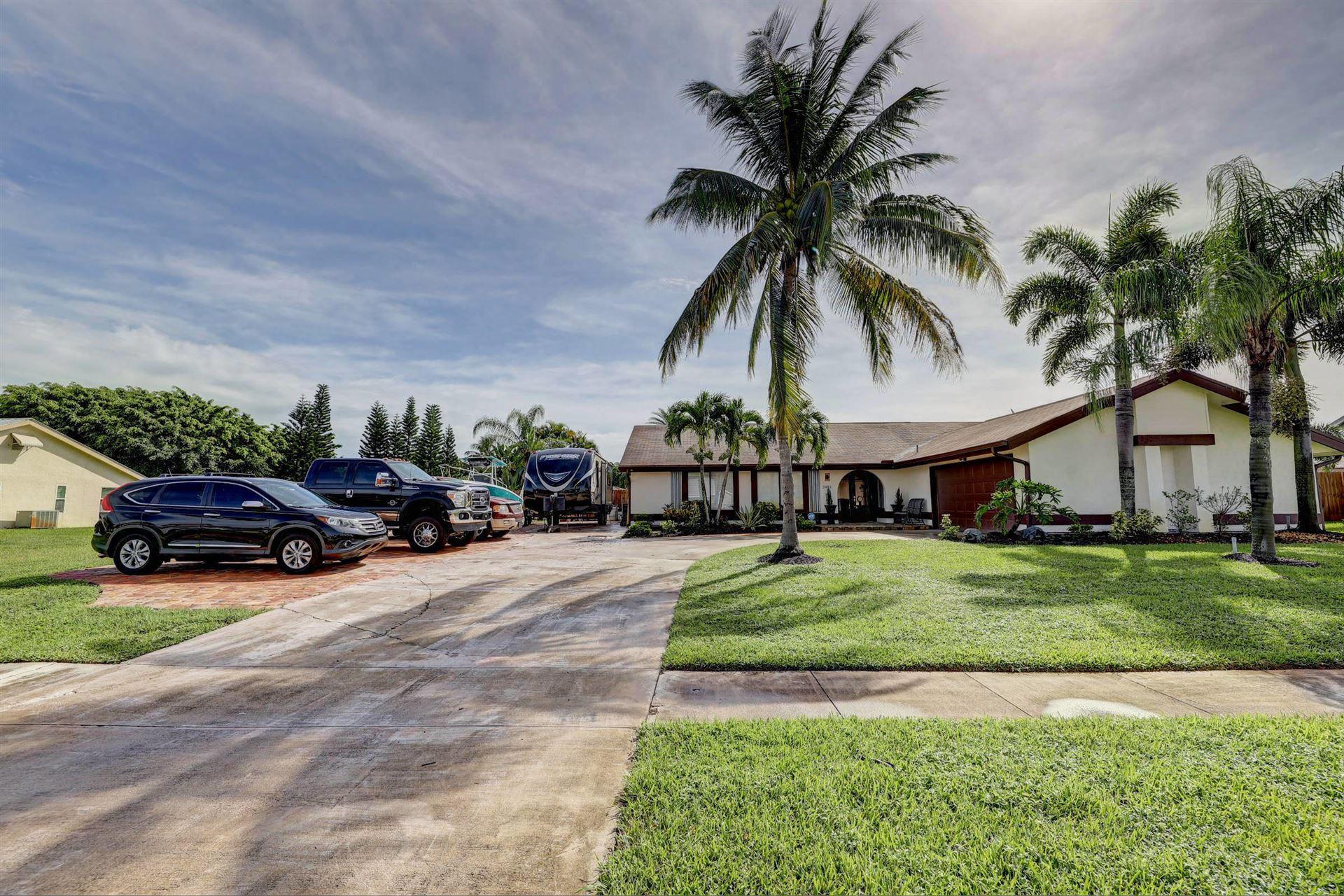 Photo of 2473 SE Gowin Drive, Port Saint Lucie, FL 34952 (MLS # RX-10660924)