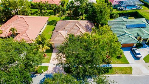 Photo of 115 Kapok Crescent, Royal Palm Beach, FL 33411 (MLS # RX-10716926)