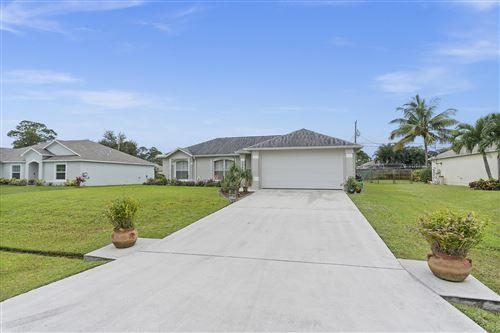 Photo of 1348 SW Axtell Avenue, Port Saint Lucie, FL 34984 (MLS # RX-10673927)