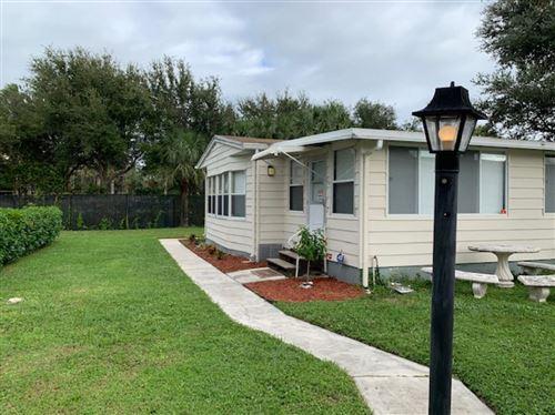 Photo of 2555 Pga Boulevard, Palm Beach Gardens, FL 33410 (MLS # RX-10673930)