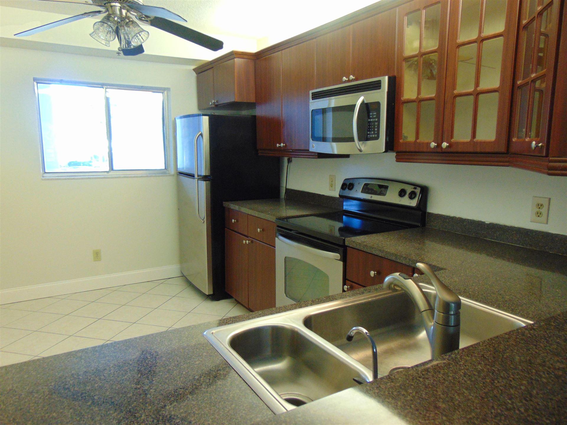 Photo of 3178 Via Poinciana #207, Lake Worth, FL 33467 (MLS # RX-10686933)
