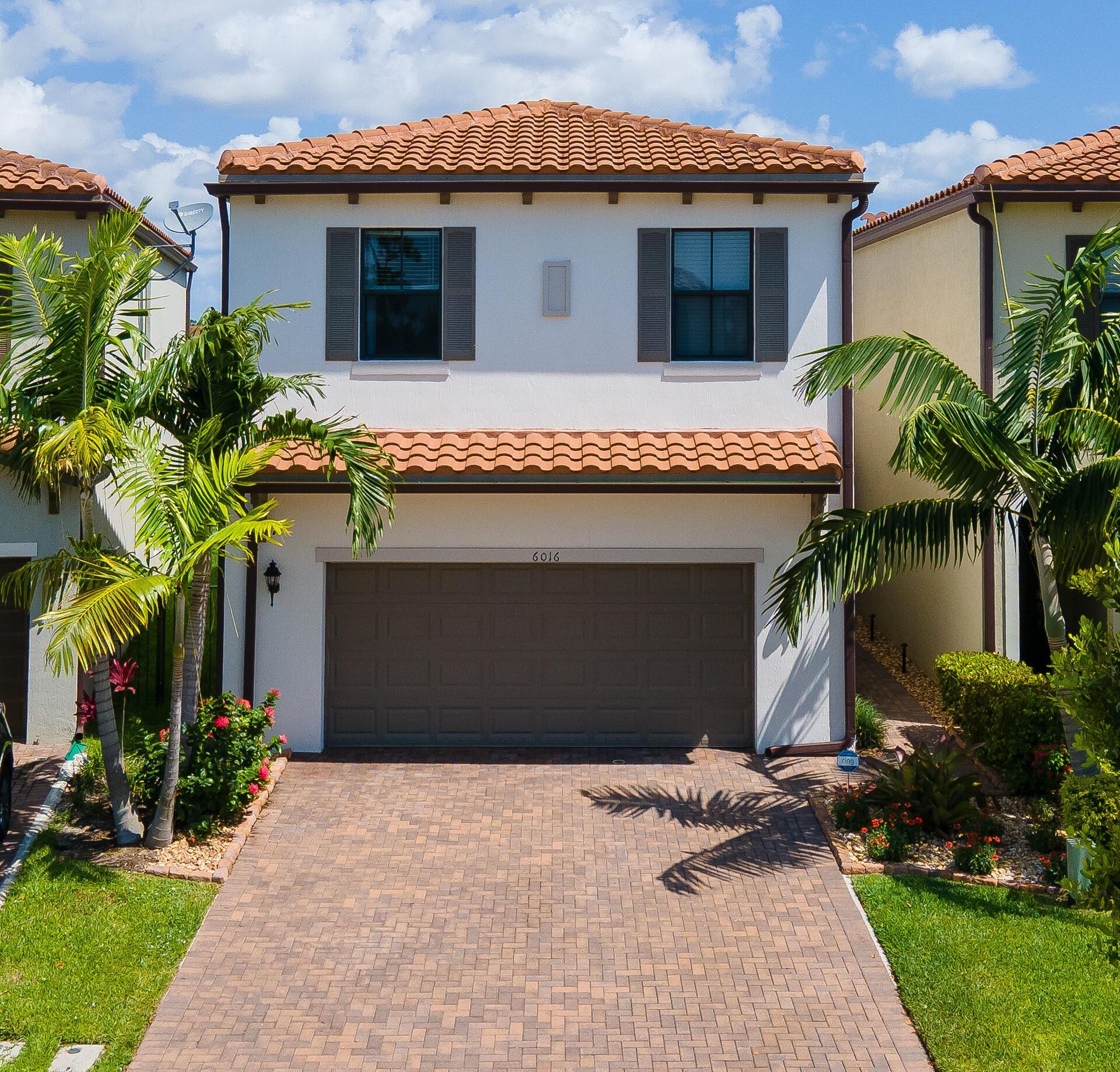 Photo of 6016 Pine Tree Way, Riviera Beach, FL 33410 (MLS # RX-10743933)
